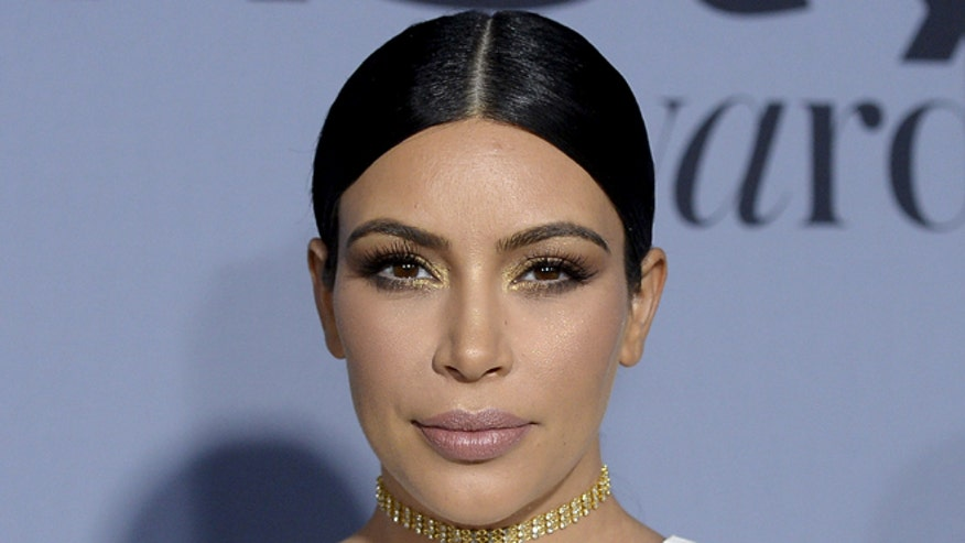 Kim Kardashian Continues To Flaunt 42 -pound Weight Loss In Curve-hugging Dress