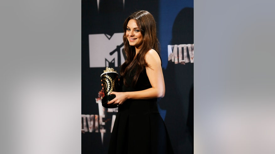 mila kunis in black dress reuters.jpg