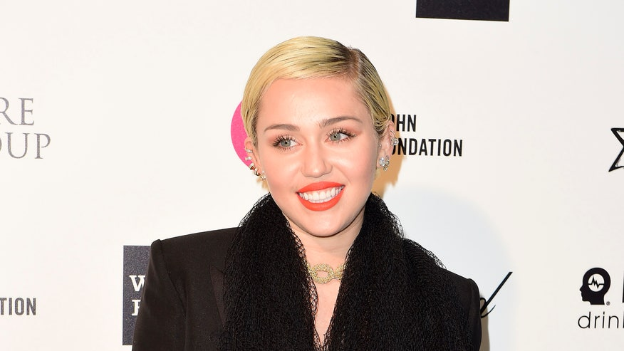 miley heart bag reuters.jpg