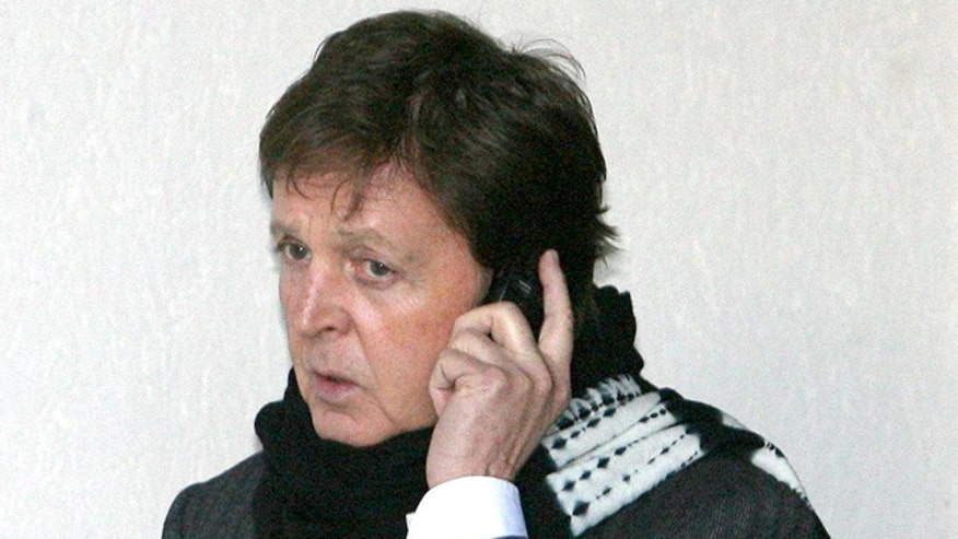 paul_mccartney_on_phone.jpg