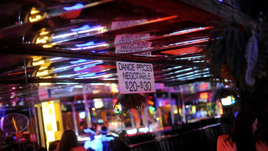 strip club lap dance sign reuters.JPG