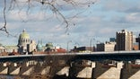 Pennsylvania's capital city has been struggling with enormous debts and, most recently, an SEC lawsuit. Area business owners say the city's financial issues have led to an increase in crime that's hurting sales, yet they remain optimistic about the future.