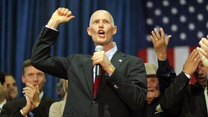 A television commercial for Florida Gov. Rick Scott's re-election campaign features an endorsement from a successful Cuban-born grocery store owner. But the man was convicted in  of smuggling migrants.