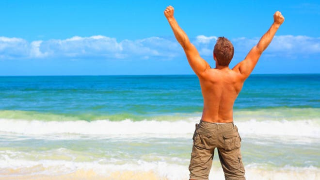 man celebrating beach