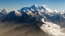 An avalanche swept down a climbing route on Mount Everest early Friday, killing at least  Nepalese guides and leaving four missing in the deadliest disaster on the world's highest peak.
