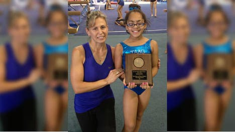 At  years old, Adrianna Kenebrew dreams of going to the Olympics to win gold as a gymnast— and she won't let the fact that she's legally blind stand in the way.