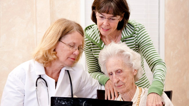 Senior woman visiting with her doctor or caregiver iStock