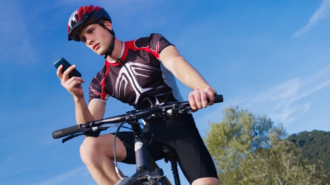 iPhone%20cyclist%20istock - 3 fitness apps you need right now