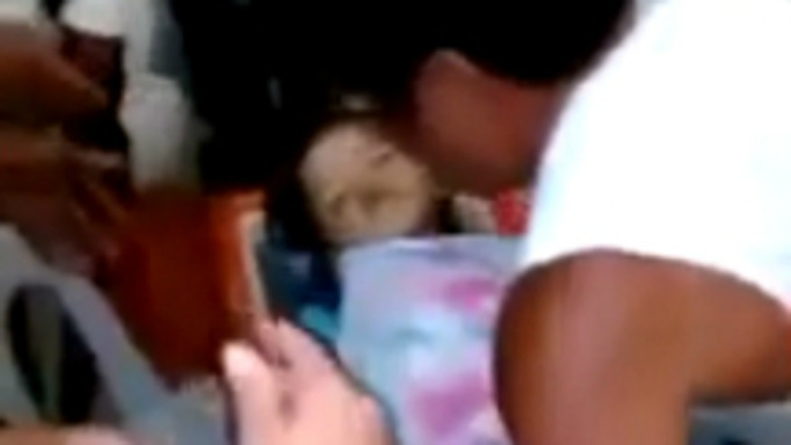 'Dead' girl wakes up in coffin during her own funeral