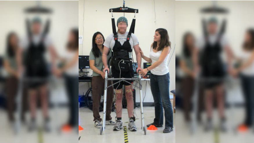 Brain-computer link enables paralyzed California man to walk