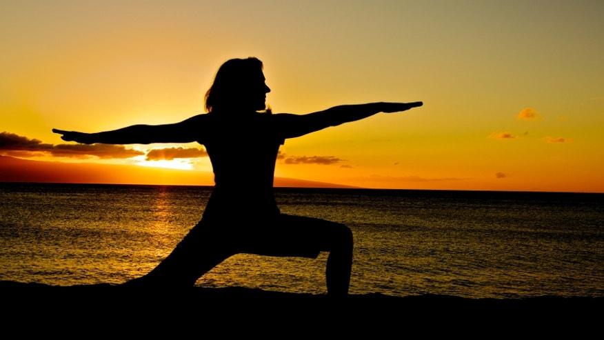 A sun salutation a day may keep the doctor away Yoga_warrior2_sunset_istock