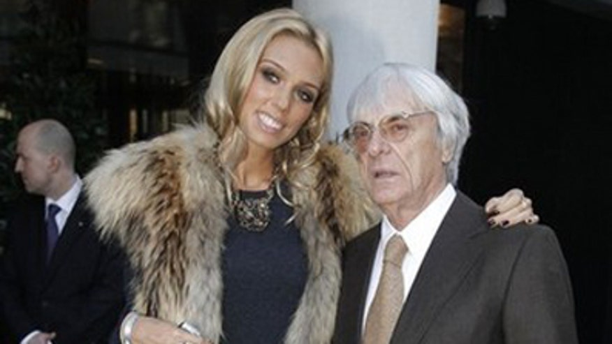 Formula One Chief, Bernie Ecclestone, and his daughter Petra, pose for photographers at the launch of One Hyde Park, in London January 19, 2011.