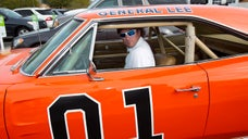 Brian Grams doesn't need another bright orange  Dodge Charger – but says he's in a race against time to buy the first General Lee  car before its current owner, golf-pro Bubba Watson, makes good on his promise to paint over the Confederate flag emblazoned on the roof of the vehicle.