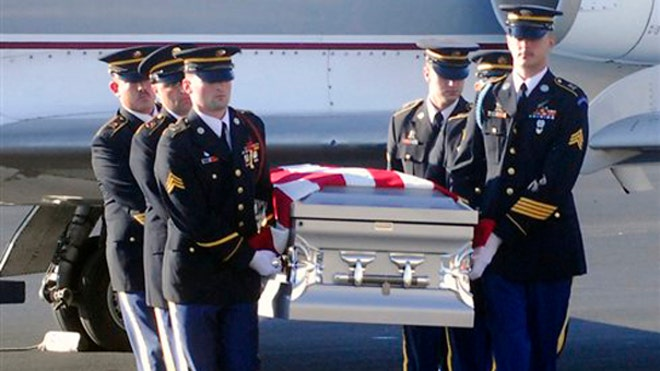 The body of Spc. Fred Greene arrives at Tennessee airport