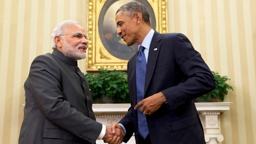 After a bear hug,Obama gets down to business with Modi in India