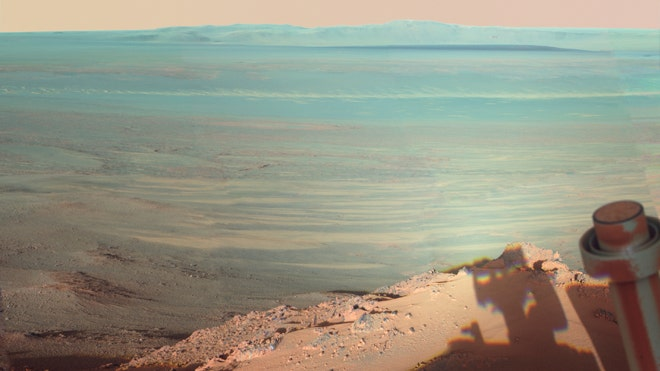The late-afternoon shadow cast by the Mars rover Opportunity at Endeavour Crater. The six-wheel rover landed on Mars in January 2004 and is still going strong. (AP Photo/NASA)