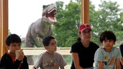 Thirty-one types of life-sized dinosaurs are stomping through backyards -- both terrifying and delighting children -- at the Field Station: Dinosaurs attraction, which opened May  in the New Jersey Meadowlands.