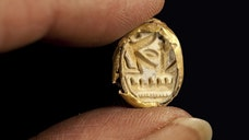 Archaeologists uncovered a Bronze Age ceramic coffin and a golden scarab in Israel's Jezreel Valley, the Israel Antiquities Authority (IAA) announced Wednesday.