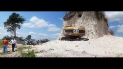 A construction company has essentially destroyed one of Belize's largest Mayan pyramids with backhoes and bulldozers to extract rock for a road-building project.