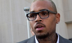 Chris Brown pleaded guilty on Tuesday to hitting a man outside a Washington hotel, an assault that occurred while the singer was on probation for attacking his then-girlfriend Rihanna.