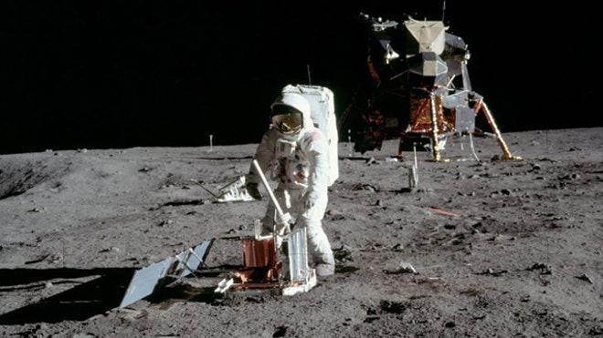 Buzz Aldrin deploys a seismometer on the moon
