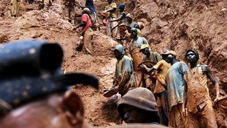 Men work in a gold mine Congo.jpg