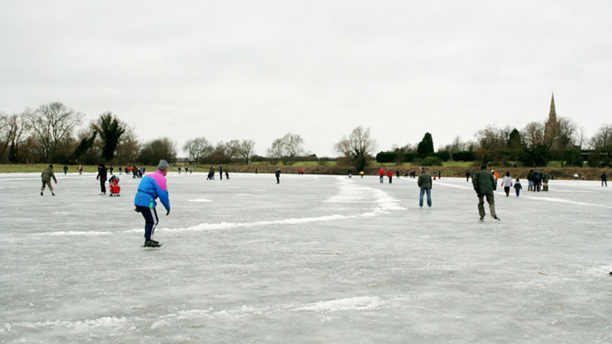 hockey skaters on pond.jpg
