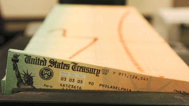 FILE: Trays of printed social security checks wait to be mailed from the U.S. Treasury's Financial Management services facility in Philadelphia. (AP)