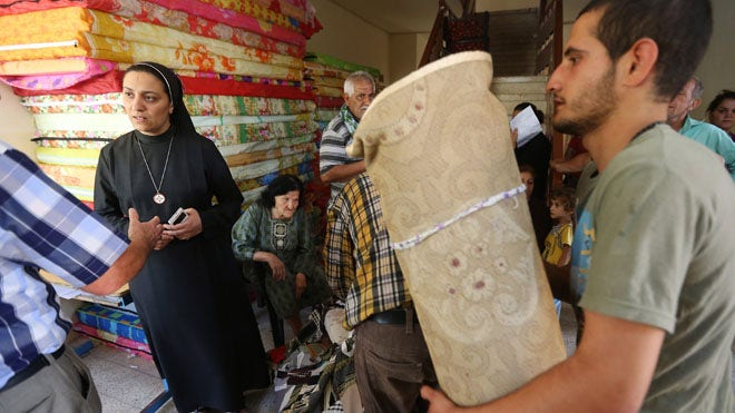 Under threat, Iraq's Christians flee city of Mosul
