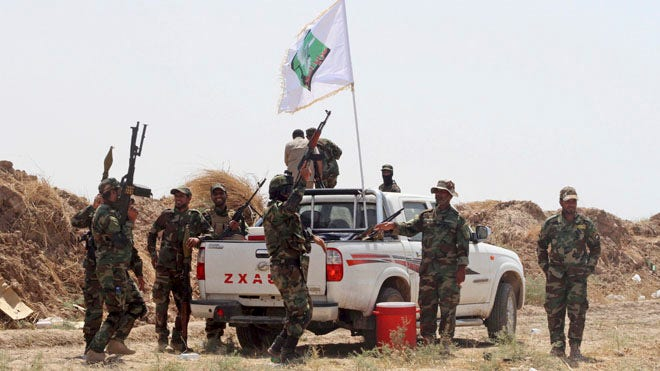 Iraqi forces claim to have broken  Islamic State siege of Shiite town