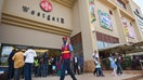 Hundreds of shoppers Saturday thronged through the re-opened Westgate Shopping Mall in Kenya's capital, Nairobi nearly two years after an extremist attack there left at least  people dead.