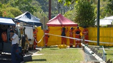 An Australian woman was charged with murder on Sunday in the deaths of seven of her children and her niece, whose bodies were found inside her home, police said.
