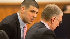 A state police trooper who specializes in fingerprint analysis testified Tuesday in the murder trial of Aaron Hernandez that the fingerprints of the former NFL player and his alleged victim, Odin Lloyd, were found inside a car that was allegedly used to drive Lloyd to his death.