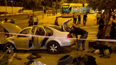 A Palestinian motorist with a history of anti-Israel violence slammed his car into a crowded train station in Jerusalem on Wednesday, killing a three-month-old baby girl and wounding eight people in what police called a terror attack.