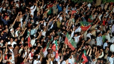 Thousands of anti-government protesters armed with wire cutters and backed by cranes marched on Pakistan's parliament Thursday, planning to remove barriers blocking them from soldiers guarding the seat of the country's government.