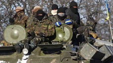 Warring parties in Ukraine took a major stride toward quelling unrest in the country's east Thursday with the declared start of a supervised withdrawal of heavy weapons from the front line.