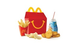 The six-year-old chicken nuggets and french fries look untouched.