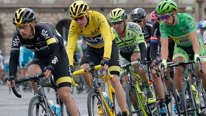 Resplendent in yellow and riding a canary yellow bike, Chris Froome has won his second Tour de France in three years, with a leisurely pedal into Paris to wrap up a spectacular three-week slog of furious racing that