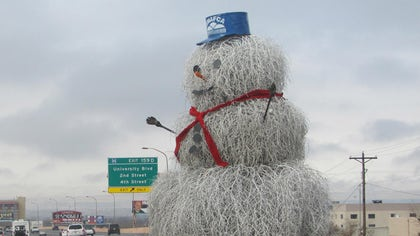 They don't wait for snow bring Frosty to life along Interstate  - they use what they had: Tumbleweeds.