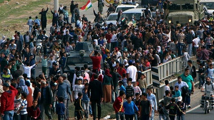 Ten Iraqi peshmerga fighters entered a northern Syrian border town, crossing over from Turkey on Thursday, the first from among a group of  Kurdish troops on their way into the embattled Kobani, activists said.