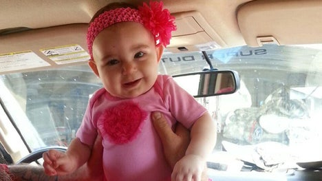 The family of Savannah Snodgrass -- a -month old Texas girl who was stricken with a brain tumor -- cried tears of joy Tuesday upon hearing the growth was benign following emergency surgery at Texas Children's Hospital in Houston.