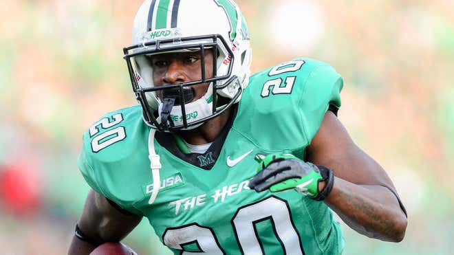 Marshall University running back Steward Butler was charged in the beating of two gay men Wednesday and was dismissed from the football team.