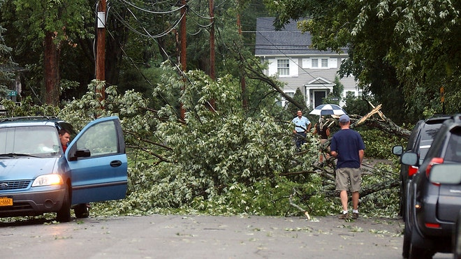 Residents work to clear tree branches off Wall Street in West Elmira, N.Y. after a severe thunderstorm swept through the area.  Read more: http://www.foxnews.com/weather/2012/07/26/city-in-upstate-new-york-on-disaster-alert-after-tornado-reported/#ixzz25uibn39Z
