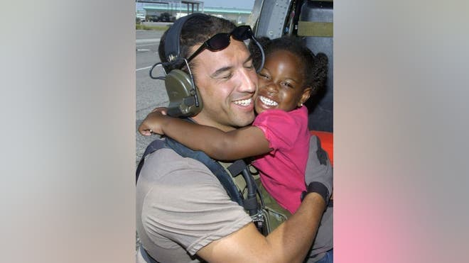 When Hurricane Katrina struck New Orleans in , Air Force Reserve Master Sgt. Mike Maroney and his team rescued a -year-old g