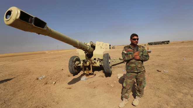 The exhausted Kurdish fighters leaned against a pair of antiquated green cannons on a hill overlooking this northern Iraqi village, the ground around them littered with shrapnel from fierce battles with Islamic State militants.