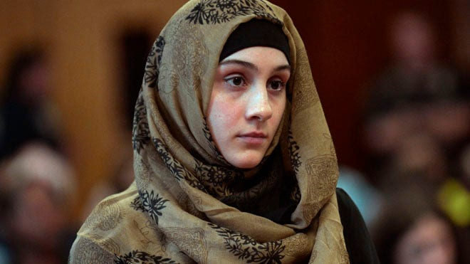 A sister of the Boston Marathon bombing suspects was led away in handcuffs Tuesday after a brief court appearance on allegations that she threatened to put a bomb on a perceived romantic rival, which her lawyer called an uncorroborated claim.