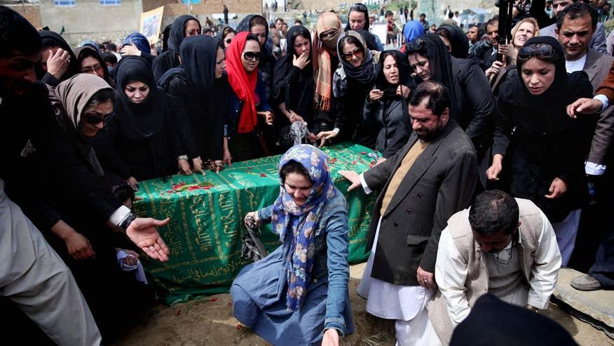 Afghanistan-womanbeatenmob.jpg