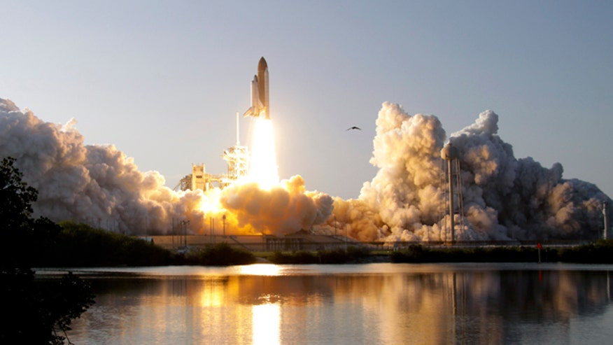 Space shuttle Discovery lifts off from Pad 39A