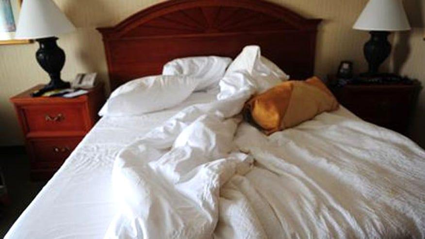 hotelroom_istock_bed.jpg