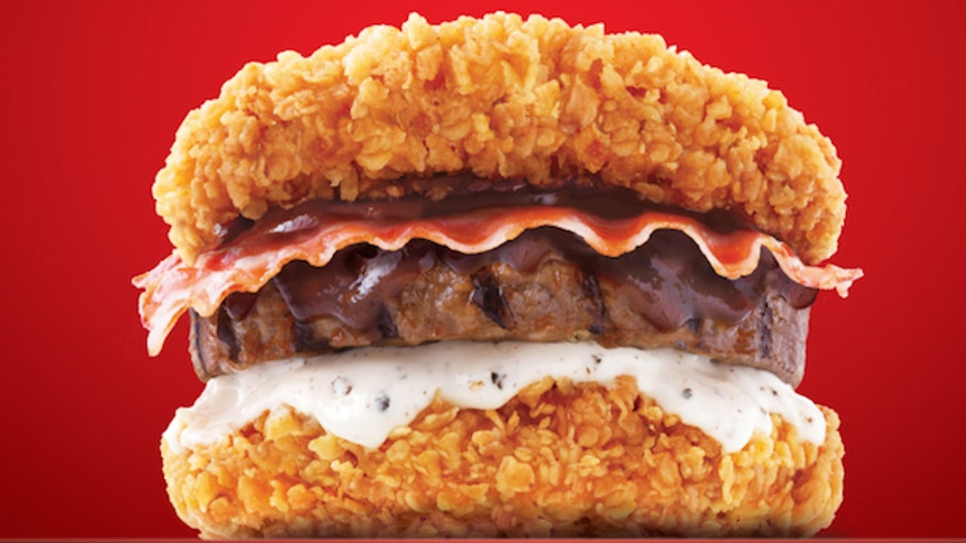 The Zinger Double Down King has two slabs of fried chicken  bacon and    Zinger Double Down